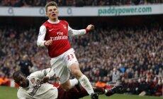 Andrejus Aršavinas (Arsenal) kovoja su Titusu Bramble'u (Sunderland)