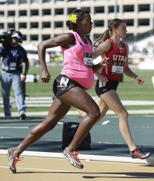 """Aštuntą mėnesį nėščia bėgikė metė iššūkį ir stojo į kovą <sup style=""""color: #ff0000;"""">FOTO</sup>"""