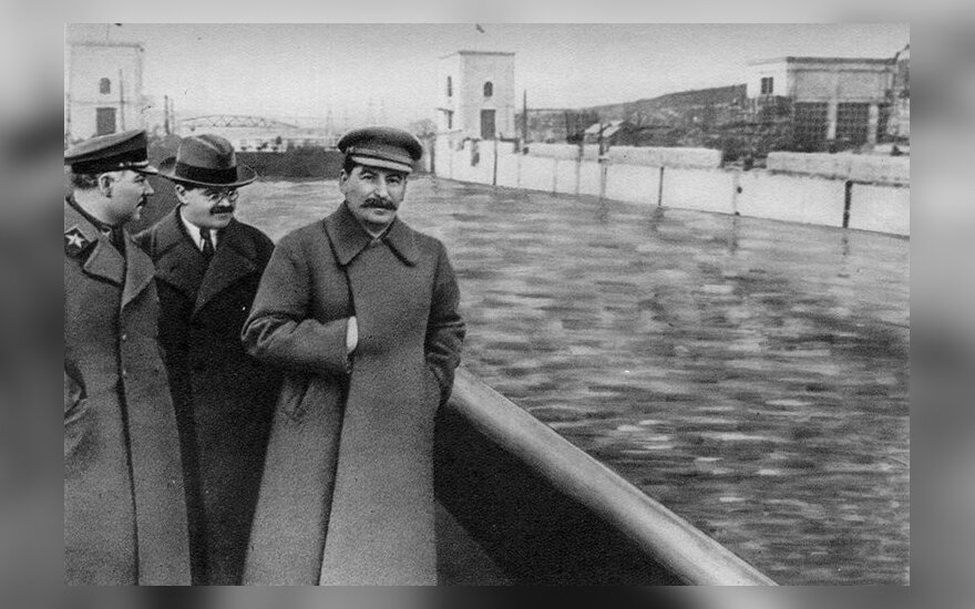 Voroshilov, Molotov, and Stalin.  Yezhov airbrushed out of history by unknow Soviet artist  Public Domain