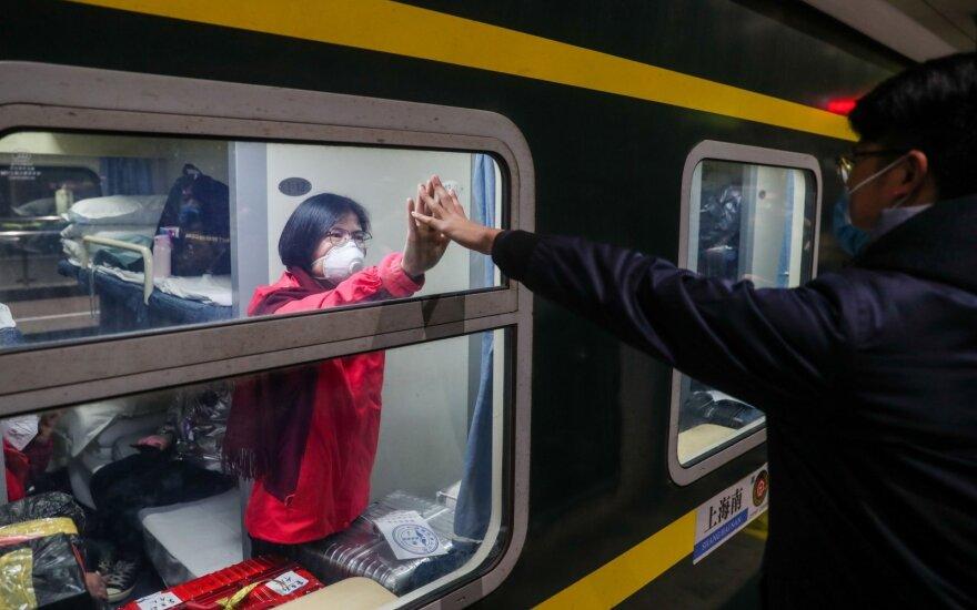 Koronaviruso protrūkis Kinijoje keičia žmonių gyvenimus