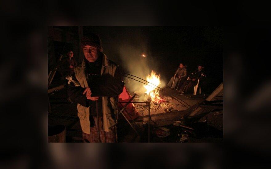 В разрушенных городах Чили— мародерство и поджоги