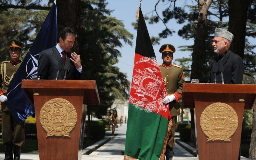 Andersas Foghas Rasmussenas ir Hamidas Karzai