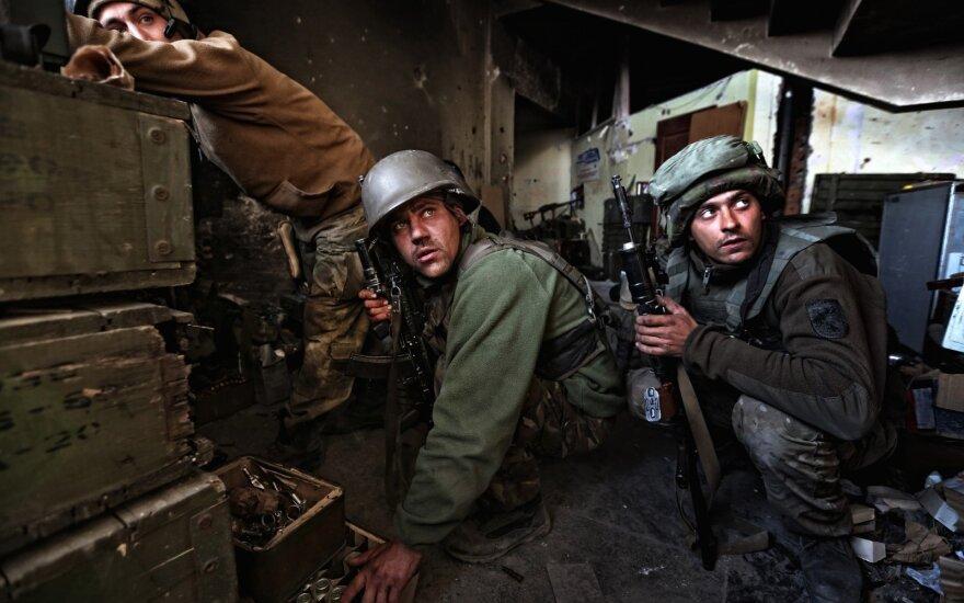 Москва: в Сахаровском центре облили краской фотографии с войны на Украине