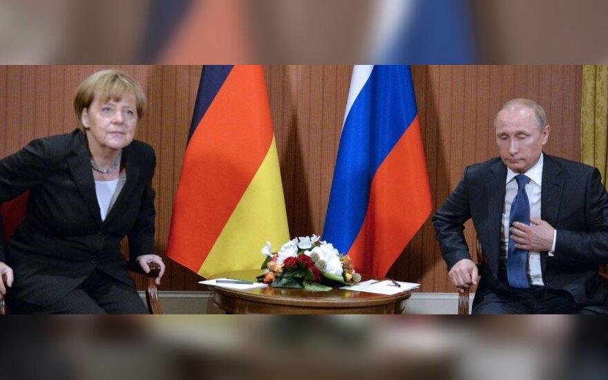 Путин и Меркель обсудили Украину за закрытыми дверями