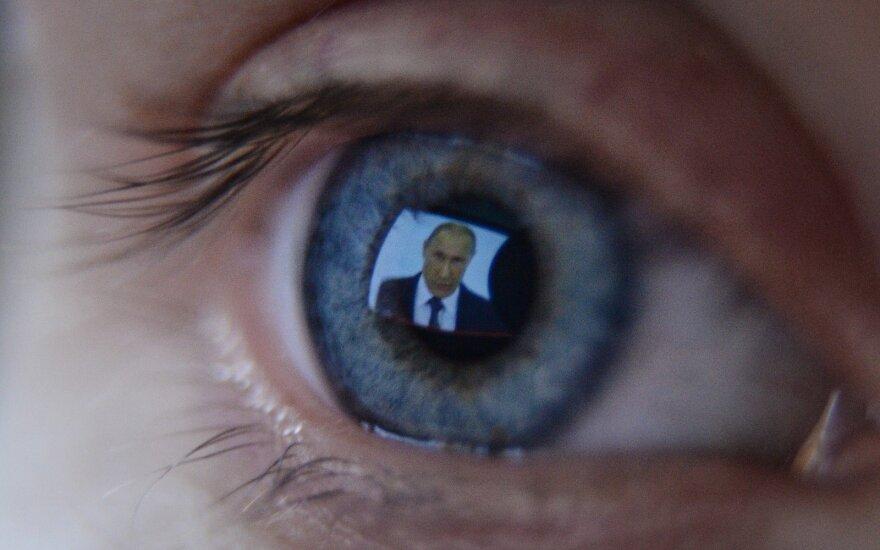 Vladimir Putin on a TV set