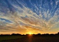 Reto grožio saulėlydžiai gniaužia kvapą: vaizdai tiesiog užburia