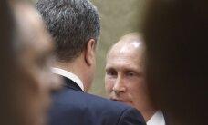"""""""Bloomberg"""": prieš P. Porošenką V. Putinas atrodo tarsi ištižėlis"""