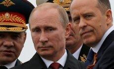 S. Šoigu, V. Putinas ir A. Bortnikovas.