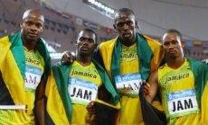 Nesta Carteris ir Usainas Boltas (apsikabinę viduryje)
