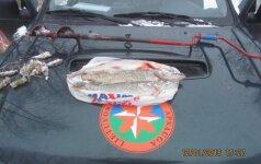 Po netikėto aplinkosaugininkų vizito žvejai mokės baudas ir neteks žvejybos priemonių