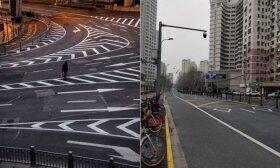 Koronaviruso padariniai: 24 mln. gyventojų turintis Šanchajus atrodo lyg vaiduoklių miestas