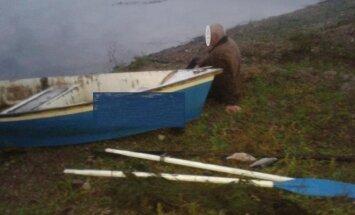 Brakonierius prie savo valties