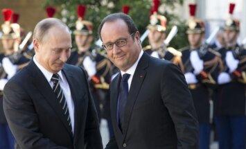 Vladimir Putin and François Hollande