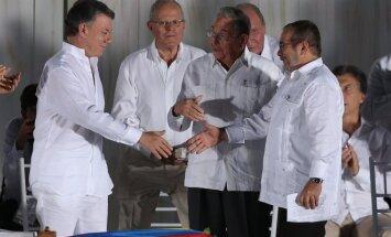 """Juanas Manuelis Santosas ir """"Farc"""" lyderis Rodrigo Londono"""