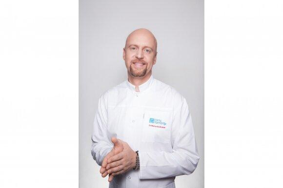 """Klinikos """"Dantų harmonija"""" implantuojantis gydytojas Marius Bučinskas"""