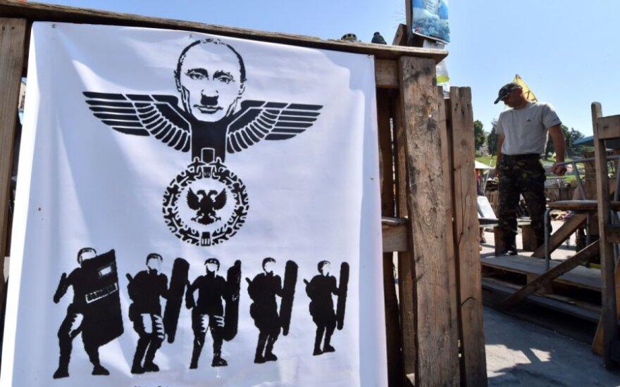 V. Putiną vaizduojantis plakatas Maidane