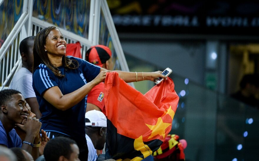 Angolan basketball team supporter with Angolan flag