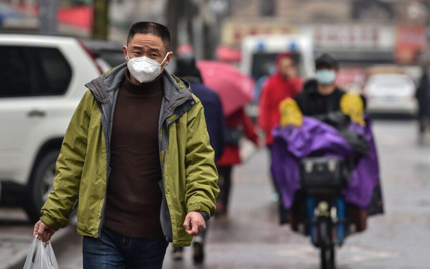 Pekino valdžia praneša apie pirmąją naujo koronaviruso auką mieste