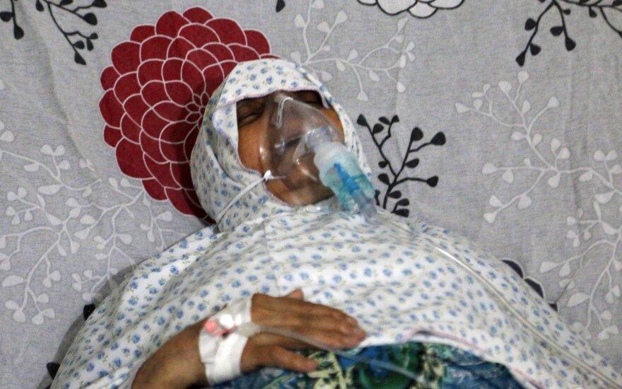 Sirija: vyriausybės pajėgos Alepe galimai surengė chloro dujų ataką