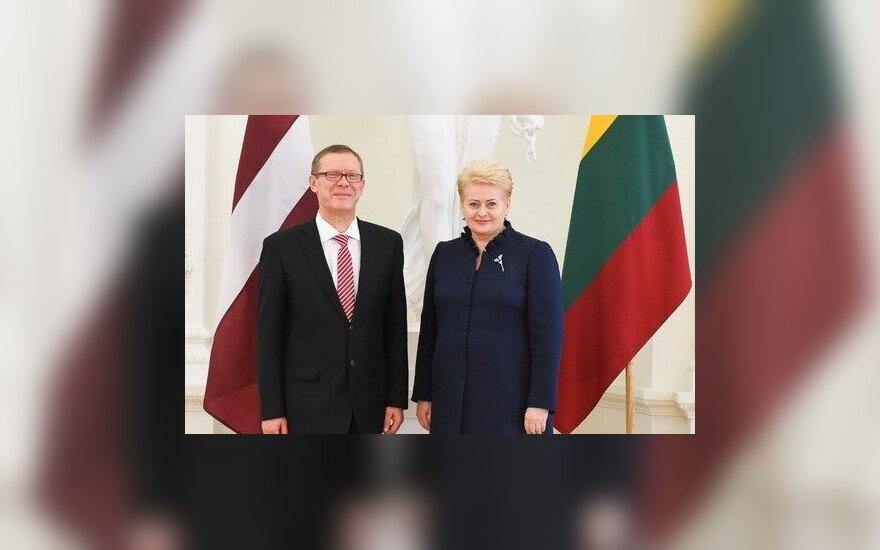 Latvian Ambassador Einars Semanis and President Dalia Grybauskaitė