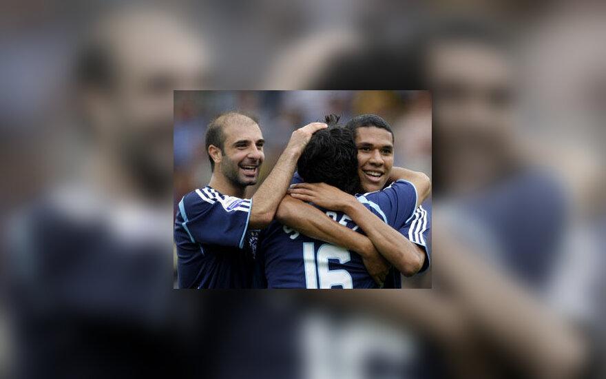 """Amsterdamo """"Ajax"""" futbolininkai džiaugiasi įvarčiu"""