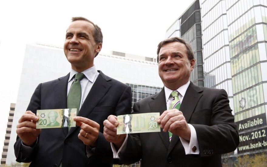 (Iš kairės): Kanados centrinio banko vadovas Markas Carney ir finansų ministras Jimas Flaherty pristato banknotus