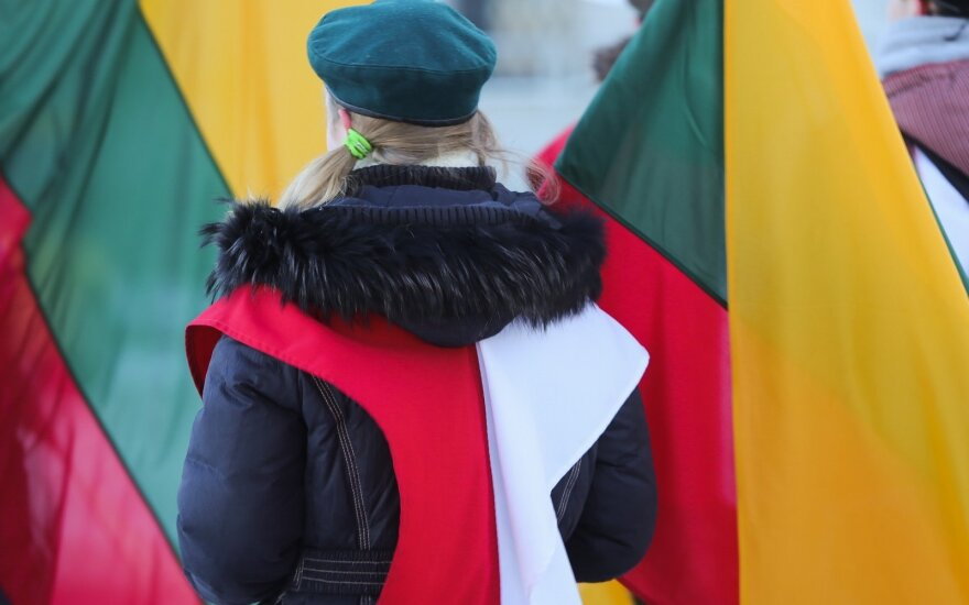 Polish girl with Lithuania's national flag