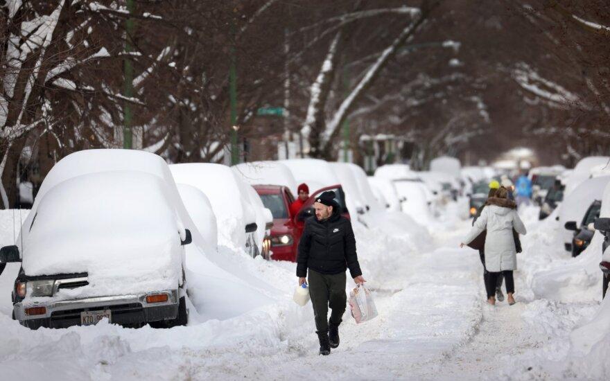 Iš JAV nesitraukiant rekordiniams šalčiams milijonai žmonių likę be elektros