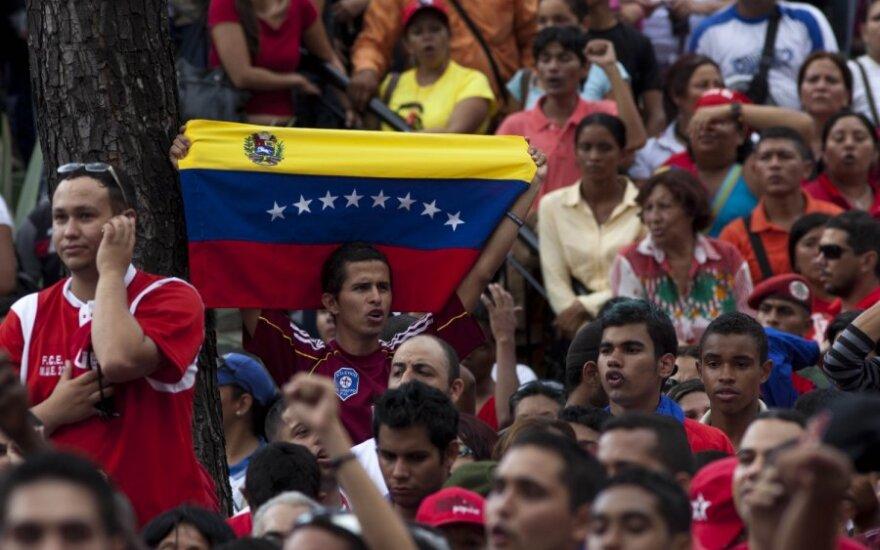 Studentas su Venesuelos vėliava