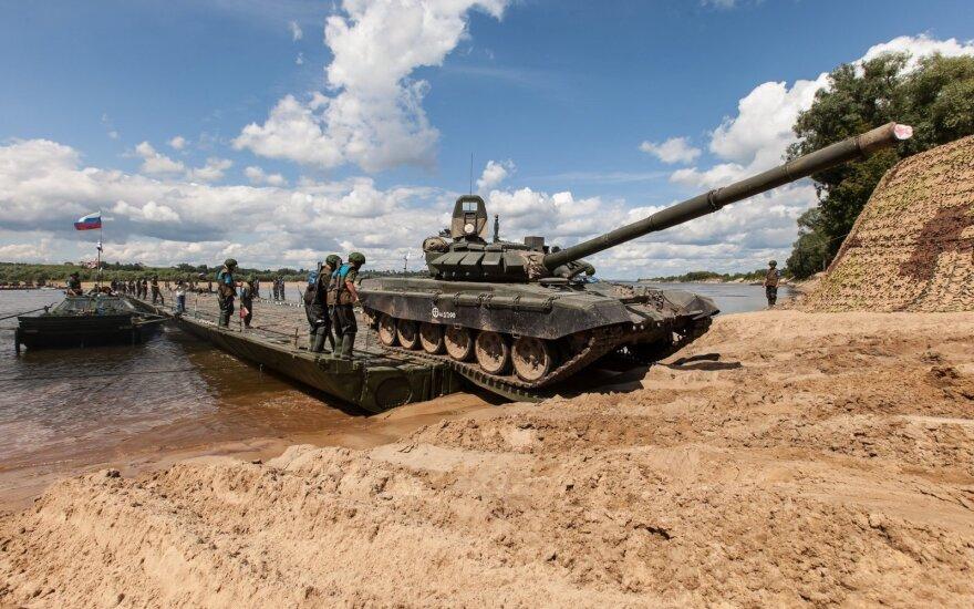 Putinas ketina mažinti karines išlaidas