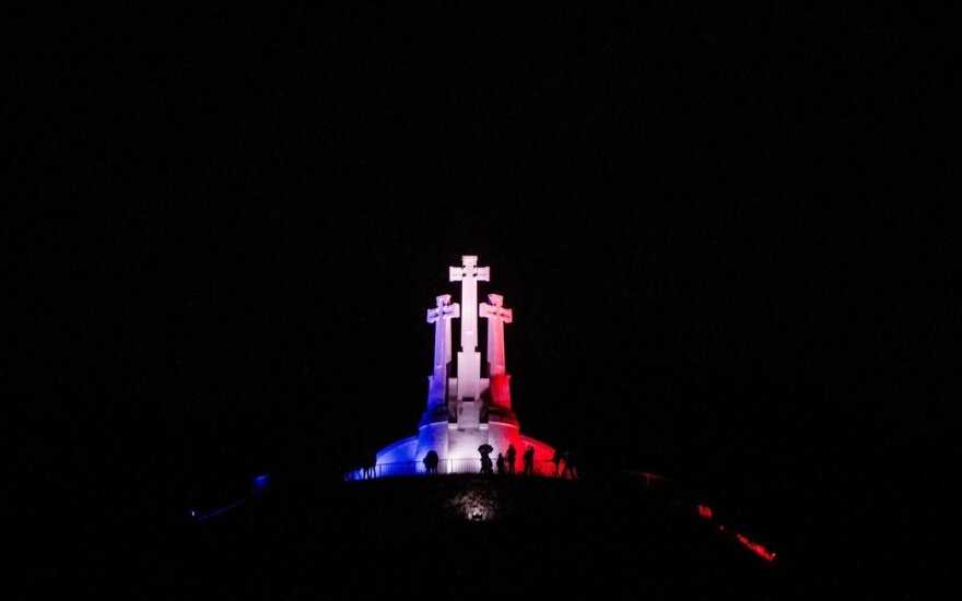 Three crosses coloured in the French flag colours