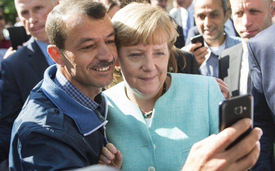 A. Merkel's selfy with a refugee