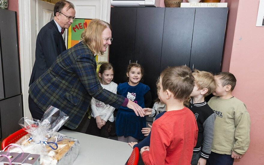 Finnish Ambassador Michelsson and Mrs Ebba Michelsson with some of the children in the kindergarten   Photo © Ludo Segers @ The Lithuania Tribune