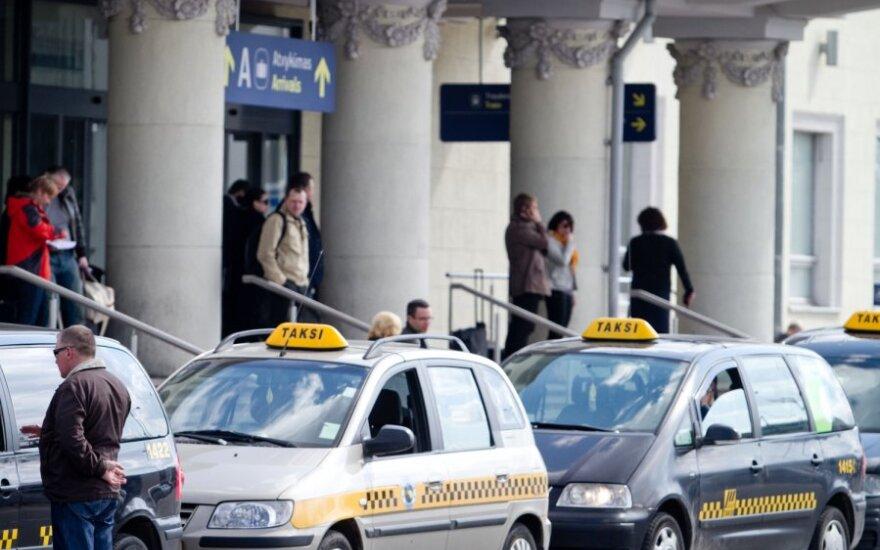 Tarp Vilniaus taksi kartelio nerado