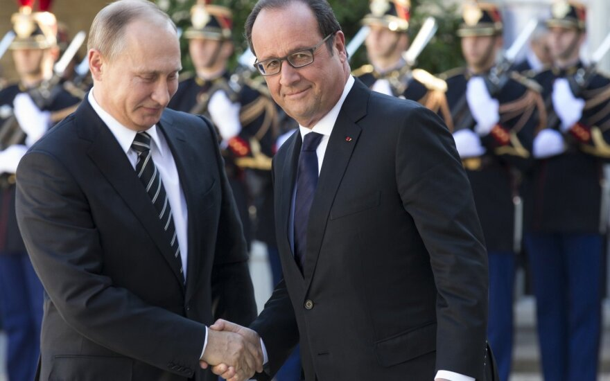 Vladimir Putin and François Hollande