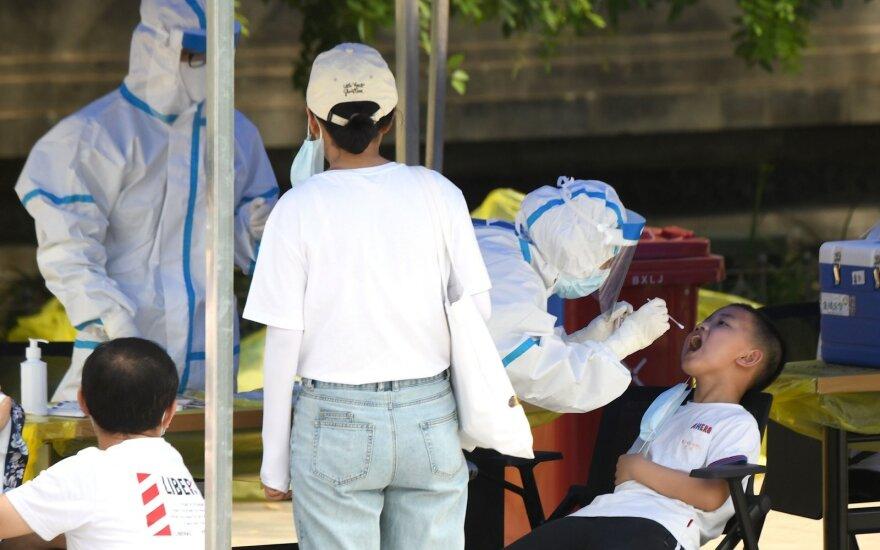 Kinijos sostinėje – naujas koronaviruso protrūkio židinys