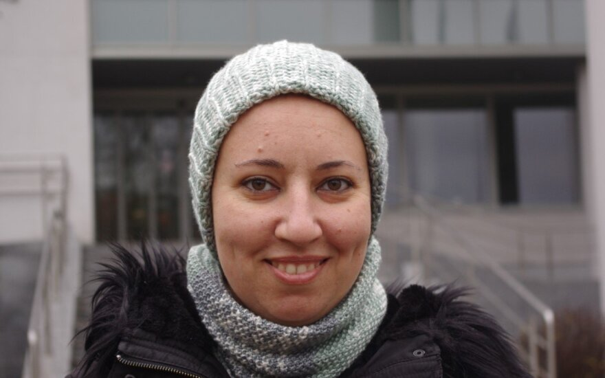 Egyptian student Rasha Geneid is pictured with knit cap and shawl that she knitted herself