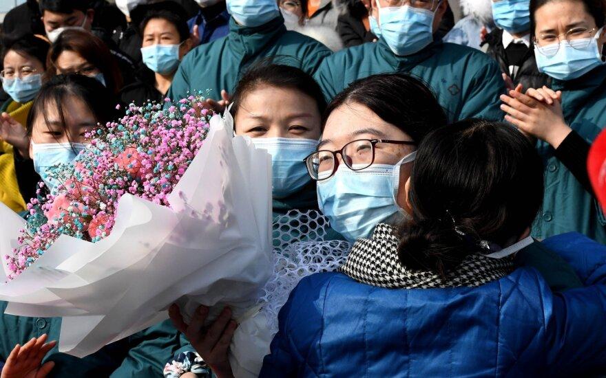 Kinijos vadovybė pripažino klaidas dėl koronaviruso epidemijos