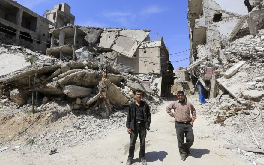 Sirijos sukilėliai pagal naują susitarimą su režimu perdavė ginklus