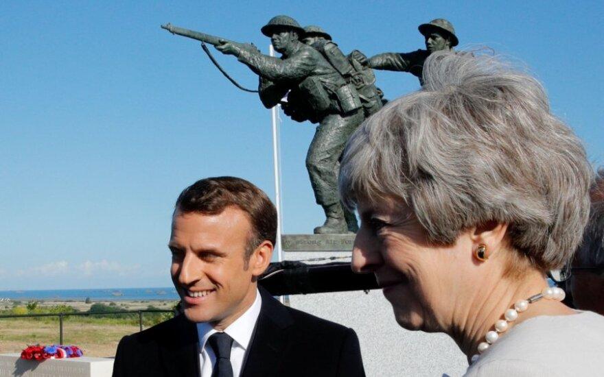 Theresa May , Emmanuelis Macronas