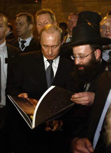 V.Putinas prie Raudų sienos